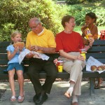 Grandparents and kids in park eating Sobik's Subs